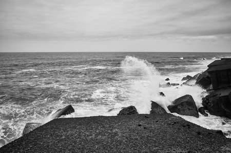 Black and white picture of waves crashing on rocks, Tenerife, Spain. Reklamní fotografie