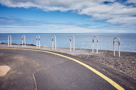 Ocean drive road, travel concept, color toning applied, Tenerife, Spain.