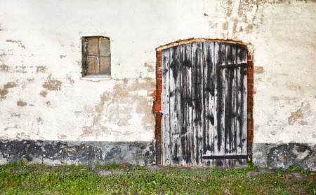 Old wooden closed door of an abandoned house.