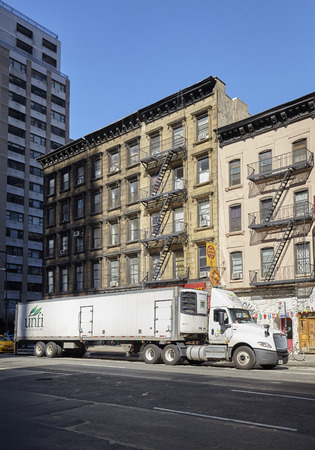 New York, USA - June 30, 2018: Semi trailer truck parked on a street of Manhattan. Redactioneel