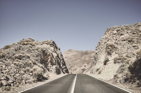 Deserted road into the unknown, color toned picture, Tenerife, Spain. Stockfoto