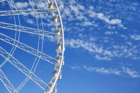 Picture of a Ferris wheel against the blue sky.