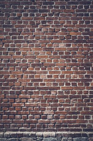 Color toned picture of a dark brick wall.