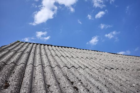Picture of a roof made of carcinogenic asbestos tiles.