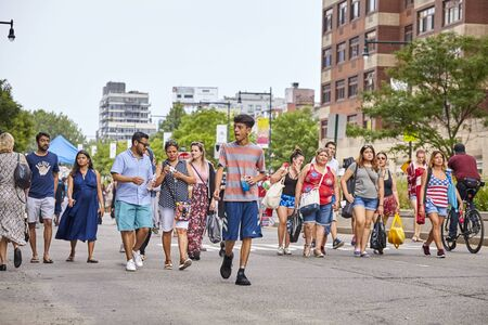 New York, USA - July 04, 2018: People walk to see 4th of July fireworks in the Gantry Plaza State Park during federal holiday in the United States commemorating the Declaration of Independence.
