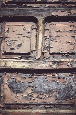 Old wooden door with peeling paint, color toning applied. Stock fotó