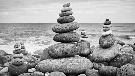 Stone stacks on a beach, balance and harmony concept.