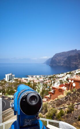 Monocular telescope pointing at horizon on a viewpoint in Los Gigantes town, Tenerife, Spain. Stok Fotoğraf