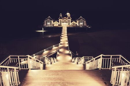 Pier in Sellin, the Jewel of Rugia (Ruegen) Baltic Coast island at Night, color toning applied, Germany.