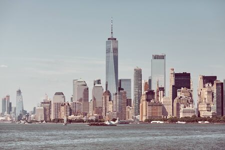 New York City skyline on a sunny day, retro color toning applied, USA.