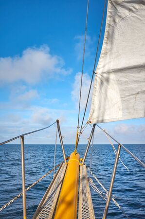 Seascape seen from an old sailing ship bow, travel concept.
