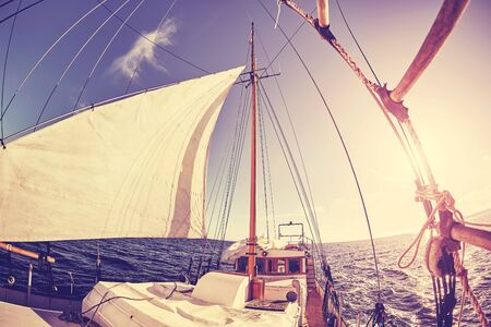 Fisheye lens picture of an old sailing ship at sunset, color toning applied.