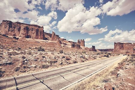 Scenic road in Arches National Park, color toning applied, Utah, USA. Reklamní fotografie