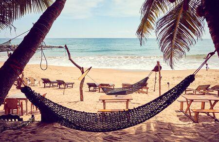 Tropical beach with hammock, color toning applied, Sri Lanka.