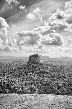 Black and white view of Sigiriya rock fortress from Pidurangala Rock, Sri Lanka.