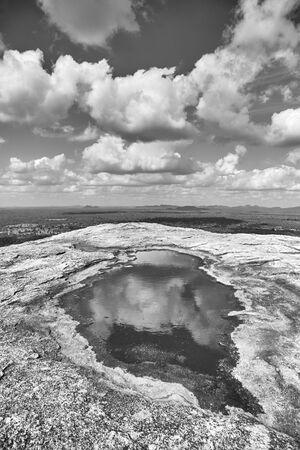 Black and white picture of the top of Pidurangala Rock, Sri Lanka. Stock Photo