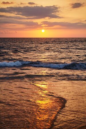 Golden sunset over the sea, focus on horizon.