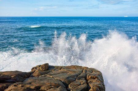 Waves crashing against the rocky shore, Sri Lanka.