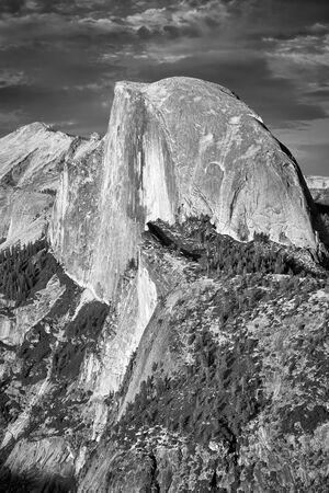 Black and white picture of Half Dome, famous granite dome of Yosemite Valley, California, USA. Stock Photo