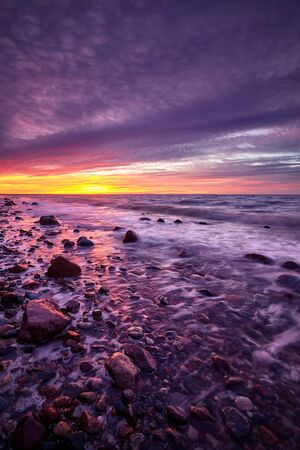 Purple sunset over beautiful beach in Wolin National Park, Poland.
