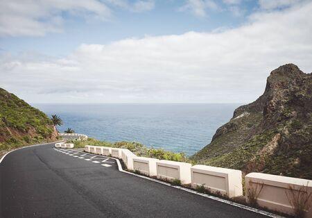 Scenic ocean drive in Anaga Rural Park, color toned picture, Tenerife, Spain.