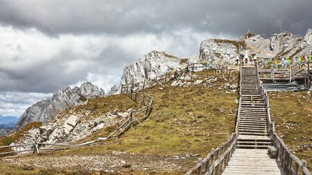 Shika Snow Mountain Scenic Area ( Blue Moon Valley) with rainy clouds, China.
