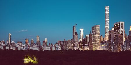 Manhattan Upper East Side over Central Park at dusk, color toning applied, New York City, USA.