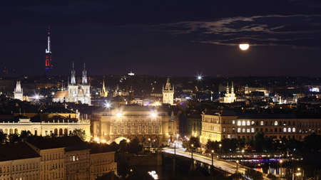 Prague cityscape at full moon night, Czech Republic. 스톡 콘텐츠