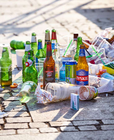 Szczecin, Poland - July 19, 2020: After party beer bottles and garbage left on the pavement of Lasztownia Island boulevard. 新闻类图片
