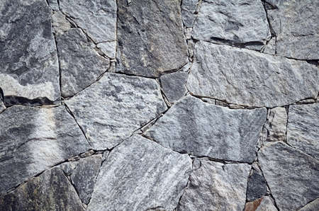 Wallpaper made of marble pieces of various shapes and sizes, rough surface texture or background. Reklamní fotografie