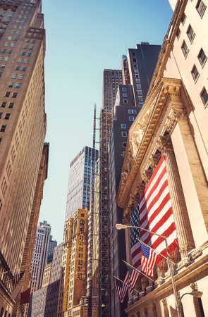 Vintage toned picture of Wall Street in Manhattan, New York City, USA.