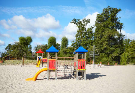 Empty outdoor playground on a beach on a sunny day.