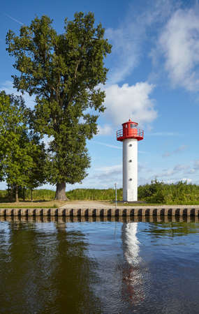 Lighthouse at the Uecker river in Ueckermunde on a sunny day, Germany. Standard-Bild