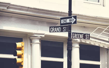 Grand and Greene Street signs in New York City, color toning applied, USA. Standard-Bild