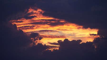 Hole in the sky, spectacular purple and orange sunset. Standard-Bild