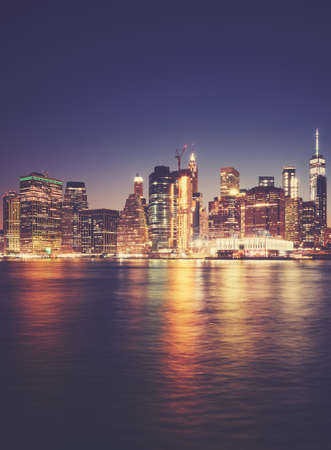 Manhattan waterfront at night, color toned picture, New York City, USA. Standard-Bild