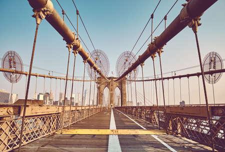 Retro toned picture of Brooklyn Bridge, New York City, USA.