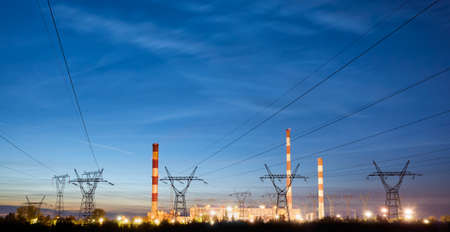 Panoramic view of a power station at dusk.