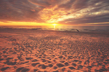 Scenic beach at a beautiful sunset, color toned picture. Standard-Bild