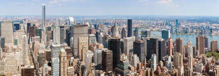 Panoramic view of New York City skyline on a sunny summer day, USA.