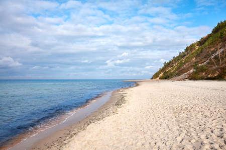 Wide sandy beach in Miedzyzdroje on a sunny day, Poland.