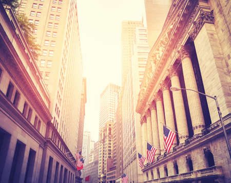 Wall Street in New York City at sunset, color toning applied, USA. Banco de Imagens