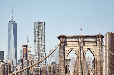 Brooklyn Bridge with Manhattan skyline in background, color toning applied, New York City, USA. Banco de Imagens