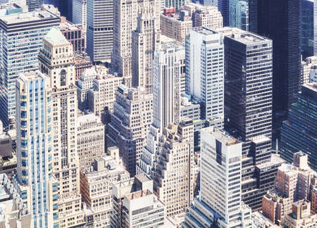 Aerial view of diverse architecture of New York City, color toning applied, USA.
