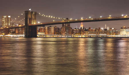 Brooklyn Bridge at night, USA. Stock Photo