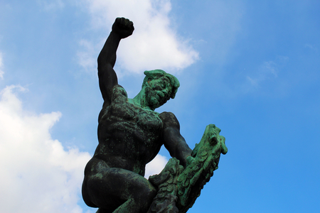 Bronze statue of a man fighting against an animal