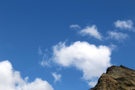 Rocks against blue sky in the mountains Stock Photo