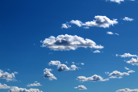Scattered cumulus clouds against blue sky