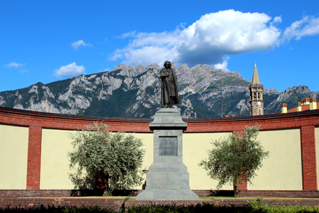 Statue of Antonio Stoppani (Italian geologist) in Lecco in front of Resegone mountain
