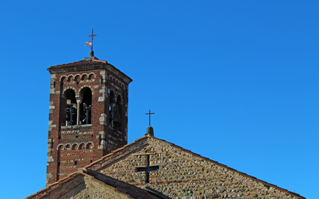 Belfry and roof top of an italian romanesque church complex